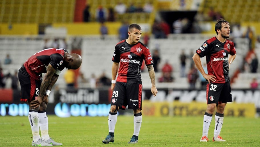 Atlas players (L-R) Felipe Baloy Christian Tabo and Alvaro Gonzalez gestures at the final  their Mexican Apertura 2015 tournament football match against Chiapas at Jalisco stadium on 06 November,2015 in Guadalajara city, Mexico. AFP PHOTO/HECTOR GUERRERO        (Photo credit should read HECTOR GUERRERO/AFP/Getty Images)
