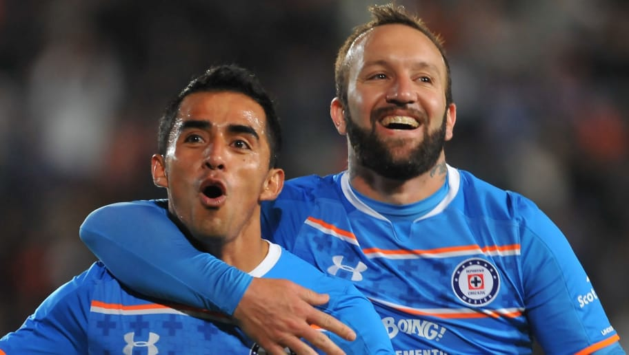 Rafael Baca (L) of Cruz Azul celebrates  with teammate Matias Vuoso (R) after scoring a goal against Pachuca during their Mexican Apertura tournament  football match at the Hidalgo stadium on November 14, 2015, in Pachuca, Mexico.   AFP PHOTO/MARIA CALLS        (Photo credit should read MARIA CALLS/AFP/Getty Images)