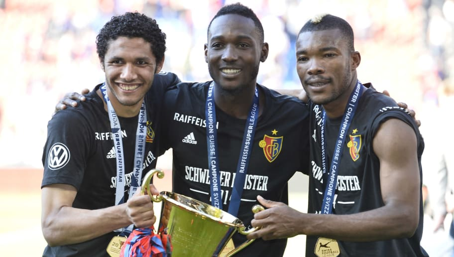 BASEL SWITZERLAND - MAY 18: Mohamed Elneny, Giovanni Sio and Geoffroy Serey Die (L-R) of FC Basel celebrates after the Raiffeisen Super League match between FC Basel and FC Lausanne Sport at St. Jakob-Park stadium on May 18, 2014 in Basel, Switzerland.  (Photo by Michael Kienzler/Bongarts/Getty Images)