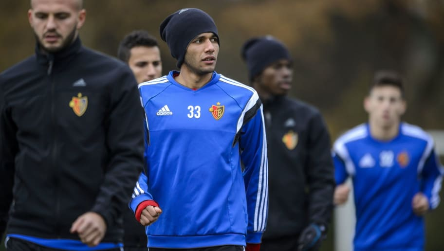 Basel's Egyptian midfielder Mohamed Elneny (C) looks on during a training session on the eve of the UEFA Champions League Group B football match between FC Basel and Real Madrid on November 25, 2014 in Basel. AFP PHOTO / FABRICE COFFRINI        (Photo credit should read FABRICE COFFRINI/AFP/Getty Images)