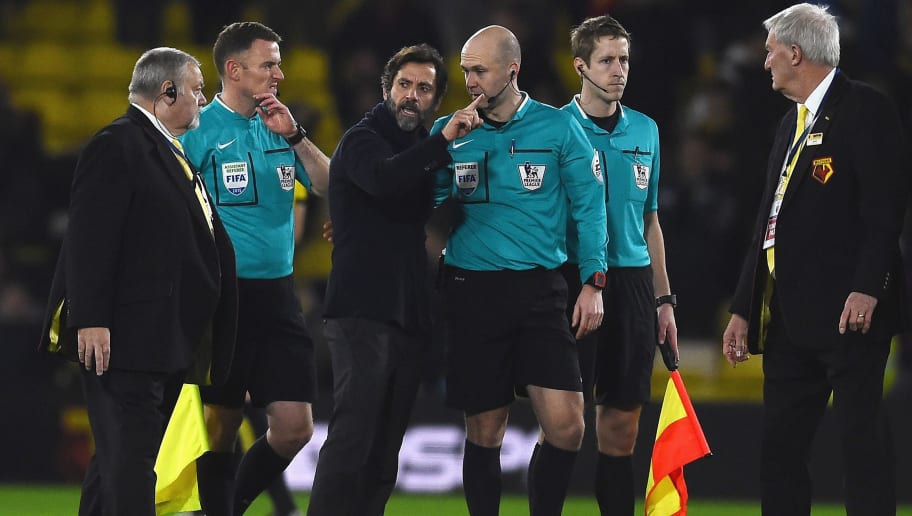 WATFORD, ENGLAND - DECEMBER 28:  Quique Flores (3rd L) manager of Watford talks with referee Anthony Taylor (3rd R) after the Barclays Premier League match between Watford and Tottenham Hotspur at Vicarage Road on December 28, 2015 in Watford, England.  (Photo by Laurence Griffiths/Getty Images)