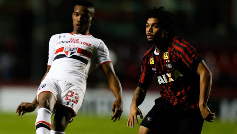SAO PAULO, BRAZIL - OCTOBER 03: Thiago Mendes (L) of Sao Paulo and Otavio of Atletico PR in action during the match between Sao Paulo and  Atletico PR for the Brazilian Series A 2015 at Morumbi stadium on October 03, 2015 in Sao Paulo, Brazil. (Photo by Alexandre Schneider/Getty Images)