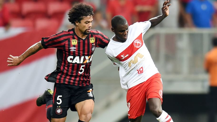 Fernandinho (L) of Brazil's Brasilia vies for the ball with Otavio of Brazil's Atletico Paranaense, during their Sudamericana Cup football match at Mane Garrincha National Stadium in Brasilia, on September 30, 2015. AFP PHOTO/EVARISTO SA        (Photo credit should read EVARISTO SA/AFP/Getty Images)