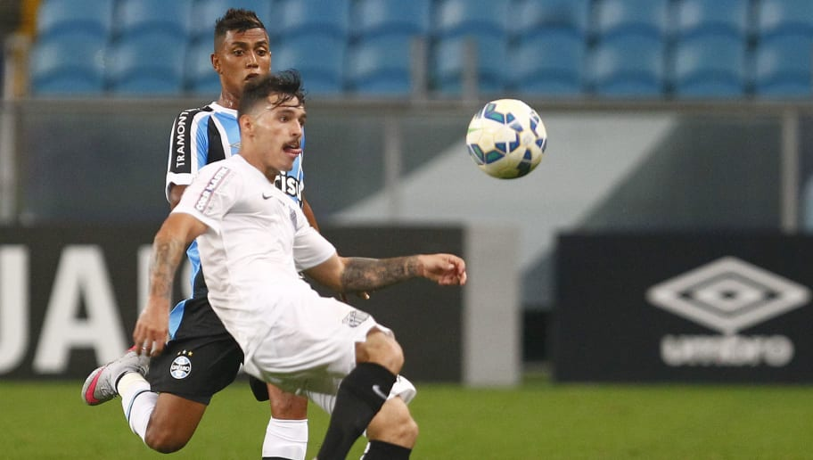 PORTO ALEGRE, BRAZIL - OCTOBER 15: Pedro Rocha of Gremio battles for the ball against Zeca of Santos during the match Gremio v Santos as part of Brasileirao Series A 2015, at Arena do Gremio on October 15, 2015 in Porto Alegre, Brazil. (Photo by Lucas Uebel/Getty Images)