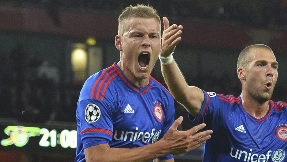 Olympiakos's Icelandic striker Alfreo Finnbogason (L) celebrates scoring their third goal with Olympiakos's Swiss midfielder Pajtim Kasami (R) during the UEFA Champions League Group F football match between Arsenal and Olympiakos at The Emirates Stadium in north London on September 29, 2015. AFP PHOTO / GLYN KIRK        (Photo credit should read GLYN KIRK/AFP/Getty Images)