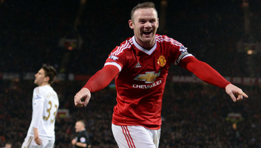 Manchester United's English striker Wayne Rooney celebrates scoring his team's second goal during the English Premier League football match between Manchester United and Swansea City at Old Trafford in Manchester, north west England, on January 2, 2016. AFP PHOTO / OLI SCARFF  RESTRICTED TO EDITORIAL USE. No use with unauthorized audio, video, data, fixture lists, club/league logos or 'live' services. Online in-match use limited to 75 images, no video emulation. No use in betting, games or single club/league/player publications. / AFP / OLI SCARFF        (Photo credit should read OLI SCARFF/AFP/Getty Images)