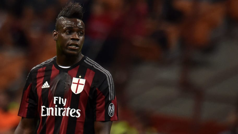 MILAN, ITALY - SEPTEMBER 19:  Mario Balotelli of Milan looks on during the Serie A match between AC Milan and US Citta di Palermo at Stadio Giuseppe Meazza on September 19, 2015 in Milan, Italy.  (Photo by Tullio M. Puglia/Getty Images)
