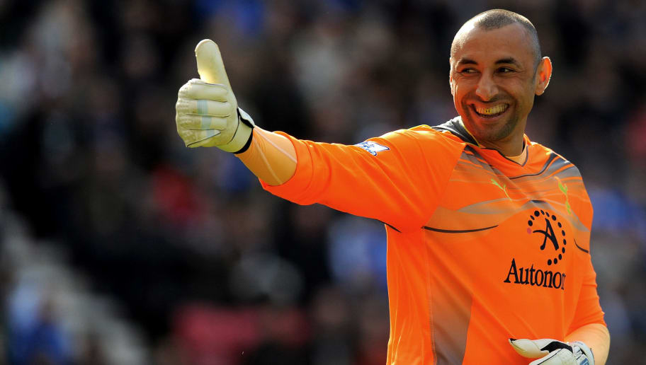 Tottenham Hotspur's Brazilian goalkeeper Heurelho Gomes reacts during the English Premier League football match between Wigan Athletic and Tottenham Hotspur at The DW stadium in Wigan, north-west England on April 2, 2011. AFP PHOTO/ANDREW YATES. FOR  EDITORIAL USE Additional licence required for any commercial/promotional use or use on TV or internet (except identical online version of newspaper) of Premier League/Football League photos. Tel DataCo +44 207 2981656. Do not alter/modify photo (Photo credit should read ANDREW YATES/AFP/Getty Images)