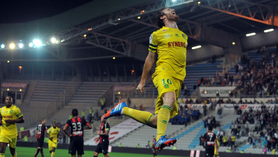 Nantes' Venezuelian-Spanish forward Fernando Aristeguieta (Up) celebrates after scoring during the French L1 football match Nantes against Nice on September 25, 2013 in La Beaujoire stadium in Nantes, western France. AFP PHOTO/FRANK PERRY        (Photo credit should read FRANK PERRY/AFP/Getty Images)