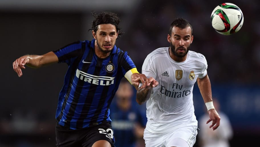 Real Madrid's Spanish forward Jese (R) and Inter Milan's Italian defender Andrea Ranocchia vie for the ball during the International Champions Cup football match between Inter Milan and Real Madrid in Guangzhou on July 27, 2015. AFP PHOTO / JOHANNES EISELE        (Photo credit should read JOHANNES EISELE/AFP/Getty Images)