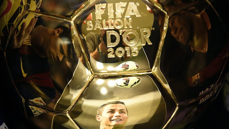 A picture taken on December 15, 2015 shows (From L) images of Barcelona's Brazilian forward Neymar, Real Madrid's Portuguese forward Cristiano Ronaldo and  Barcelona's Argentinian forward Lionel Messi, reflecting into the Ballon d'Or 2015 trophy displayed at the Mellerio jewelery workshops in Paris. The Ballon d'Or 2015, Fifa's annual football award given to the male player considered to have performed the best in the previous calendar year, will be awarded on January 11, 2016 during a gala event in Zurich. / AFP / FRANCK FIFE        (Photo credit should read FRANCK FIFE/AFP/Getty Images)
