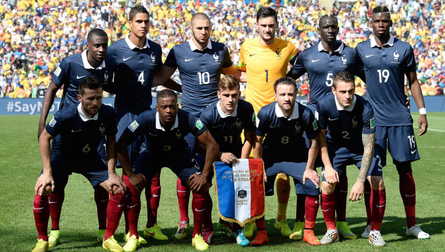 France's national team (back L-R) France's midfielder Blaise Matuidi, France's defender Raphael Varane, France's forward Karim Benzema, France's goalkeeper and captain Hugo Lloris, France's defender Mamadou Sakho and France's midfielder Paul Pogba  (front L-R) France's midfielder Yohan Cabaye, France's defender Patrice Evra, France's forward Antoine Griezmann, France's midfielder Mathieu Valbuena and France's defender Mathieu Debuchy  pose for a team prior to the quarter-final football match between France and Germany at the Maracana Stadium in Rio de Janeiro during the 2014 FIFA World Cup on July 4, 2014. AFP PHOTO / FRANCK FIFE        (Photo credit should read FRANCK FIFE/AFP/Getty Images)