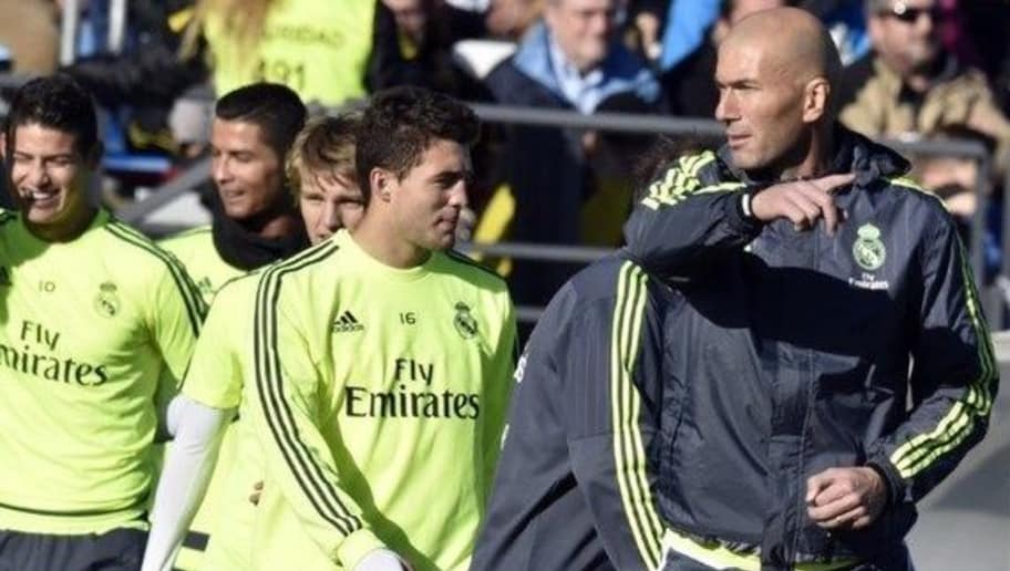 """Real Madrid's new French coach Zinedine Zidane (R) gestures during his first training session as coach of Real Madrid at the Alfredo di Stefano stadium in Valdebebas, on the outskirts of Madrid, on January 5, 2016. Real Madrid legend Zinedine Zidane promised to put his """"heart and soul"""" into managing the Spanish giants after he was sensationally named as coach following Rafael Benitez's unceremonious sacking"""