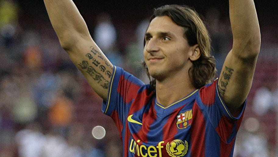 Barcelona's new signing Swedish striker Zlatan Ibrahimovic waves his fans as he is wearing his new jersey after he signed a five-year contract with Barca on July 27, 2009 in Barcelona.  AFP PHOTO / JOSEP LAGO (Photo credit should read JOSEP LAGO/AFP/Getty Images)