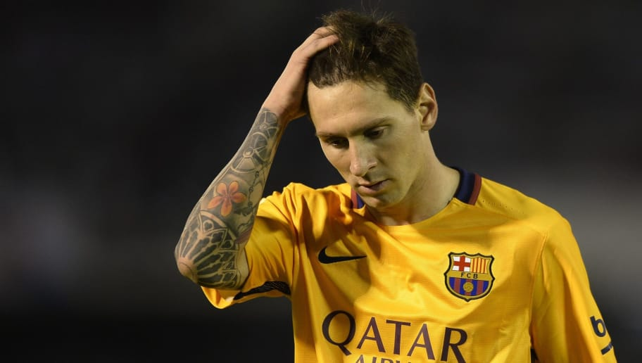 Barcelona's Argentinian forward Lionel Messi gestures at the end of the Spanish league football match Celta Vigo vs FC Barcelona at the Balaidos stadium in Vigo on September 23, 2015.  Celta won the match 4-1. AFP PHOTO / MIGUEL RIOPA        (Photo credit should read MIGUEL RIOPA/AFP/Getty Images)