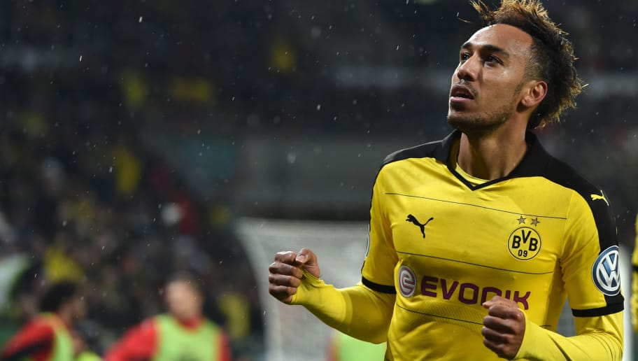 Dortmund's Gabonese striker Pierre-Emerick Aubameyang celebrates after his goal during the German Cup DFB Pokal third round match between Borussia Dortmund and FC Augsburg in Augsburg on December 16, 2015.  / AFP / Christof STACHE / RESTRICTIONS: ACCORDING TO DFB RULES IMAGE SEQUENCES TO SIMULATE VIDEO IS NOT ALLOWED DURING MATCH TIME. MOBILE (MMS) USE IS NOT ALLOWED DURING AND FOR FURTHER TWO HOURS AFTER THE MATCH. == RESTRICTED TO EDITORIAL USE == FOR MORE INFORMATION CONTACT DFB DIRECTLY AT +49 69 67880   /         (Photo credit should read CHRISTOF STACHE/AFP/Getty Images)