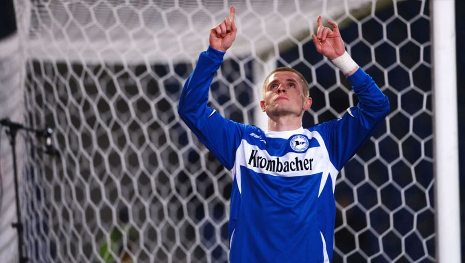 BIELEFELD, GERMANY - FEBRUARY 06: Artur Wichniarek of Bielefeld celebrates his first goal during the Bundesliga match between Arminia Bielefeld and Hertha BSC Berlin at the Schueco Arena on February 6, 2009 in Bielefeld, Germany.  (Photo by Thomas Starke/Bongarts/Getty Images)