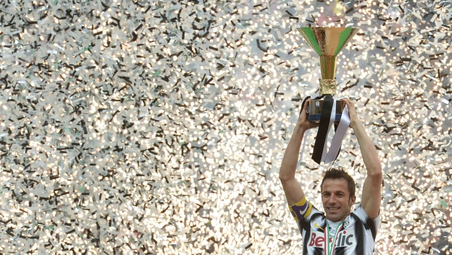 Juventus' forward Alessandro Del Piero celebrates with his team winning the Italian Serie A trophy, the Scudetto, during a ceremony after their match against Atalanta on May 13, 2012 in Juventus stadium in Turin. Juve have officially won 28 titles due to having been stripped of their 2005 and 2006 successes for match-fixing and Del Piero's 19-year stay with the Old Lady Juventus  will come to an end this summer.    AFP PHOTO / GIUSEPPE CACACE        (Photo credit should read GIUSEPPE CACACE/AFP/GettyImages)