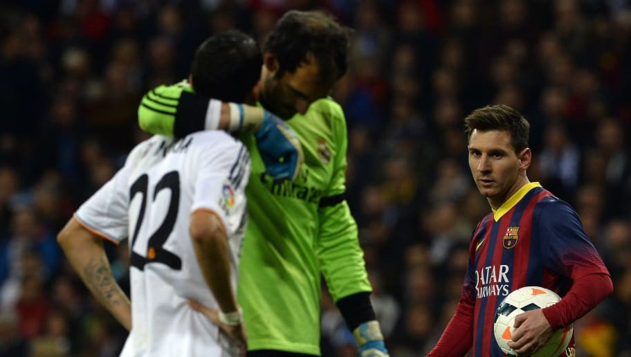 Barcelona's Argentinian forward Lionel Messi (R) looks at Real Madrid's goalkeeper Diego Lopez (C) and Real Madrid's Argentinian midfielder Angel di Maria before sooting a penalty kick during the Spanish league 'Clasico' football match Real Madrid CF vs FC Barcelona at the Santiago Bernabeu stadium in Madrid on March 23, 2014.   AFP PHOTO/ GERARD JULIEN        (Photo credit should read GERARD JULIEN/AFP/Getty Images)