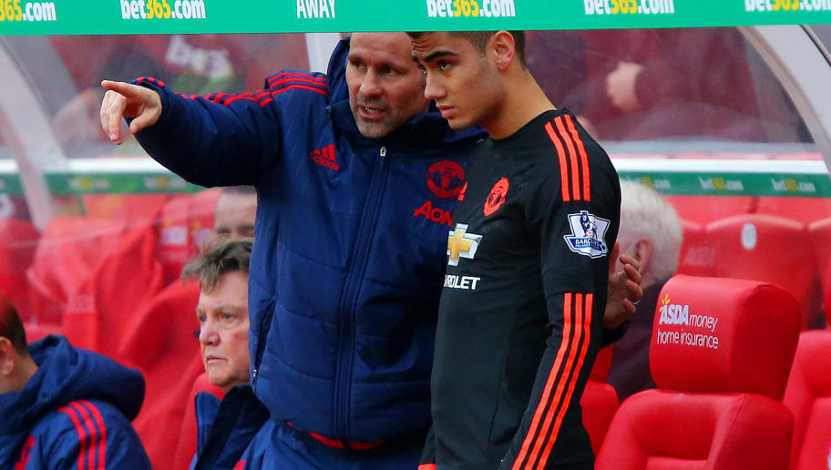 STOKE ON TRENT, ENGLAND - DECEMBER 26:  Ryan Giggs, assistant manager of Manchester United speaks with Andreas Pereira of Manchester United as he prepares to come on towards the end of the Barclays Premier League match between Stoke City and Manchester United at Britannia Stadium on December 26, 2015 in Stoke on Trent, England.  (Photo by Dave Thompson/Getty Images)