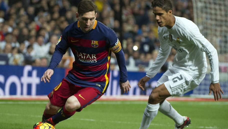 Barcelona's Argentinian forward Lionel Messi  (L) vies with Real Madrid's French defender Raphael Varane during the Spanish league 'Clasico' football match Real Madrid CF vs FC Barcelona at the Santiago Bernabeu stadium in Madrid on November 21, 2014.    AFP PHOTO / CURTO DE LA TORRE        (Photo credit should read CURTO DE LA TORRE/AFP/Getty Images)