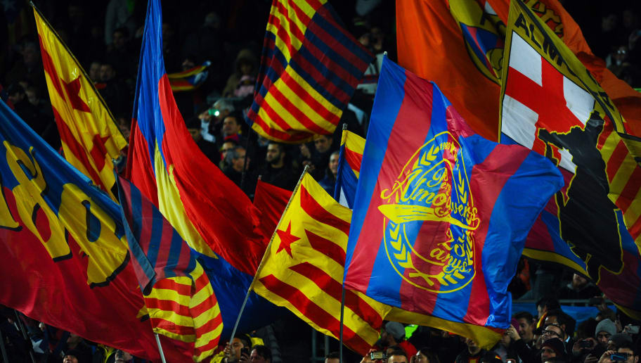 BARCELONA, SPAIN - NOVEMBER 24:  FC Barcelona supporters cheer on their team during the UEFA Champions League Group E match between FC Barcelona and AS Roma at Camp Nou stadium on November 24, 2015 in Barcelona, Spain.  (Photo by David Ramos/Getty Images)