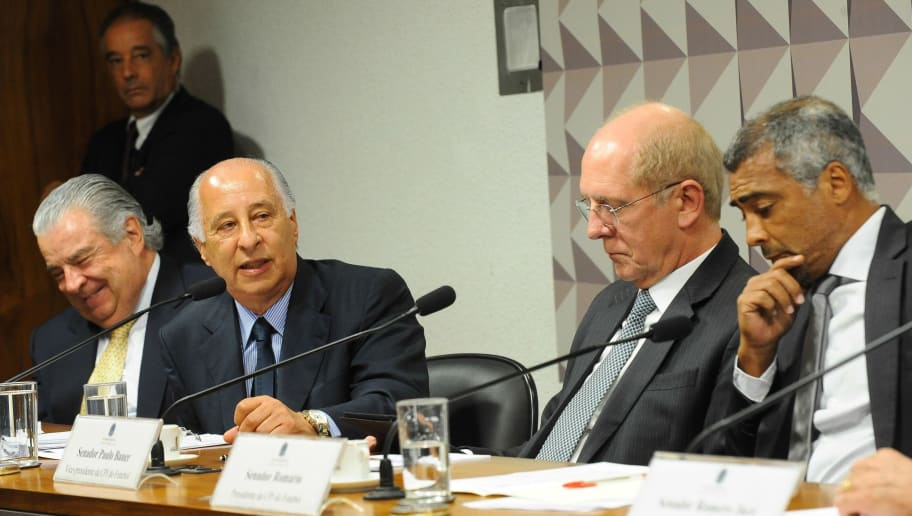 Marco Polo Del Nero (2nd-L), president on leave of the Brazilian Football Confederation (CBF) and former footballer and current senator  Romario (Romario Da Souza Faria) (R), during a public hearing of the parlamentary commission investigating the corruption in the CBF, in Brasília, on December 16, 2015. AFP PHOTO/ANDRESSA ANHOLETE / AFP / Andressa Anholete        (Photo credit should read ANDRESSA ANHOLETE/AFP/Getty Images)