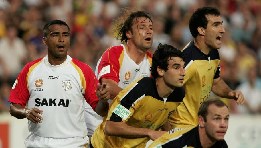 GOSFORD, AUSTRALIA - NOVEMBER 25:  Romario of Adelaide United (L) looks on as players tussle for the ball during the round fourteen Hyundai A-League match between the Central Coast Mariners and Adelaide United at Bluetongue Central Coast Stadium November 25, 2006 in Gosford, Australia.  (Photo by Mark Kolbe/Getty Images)