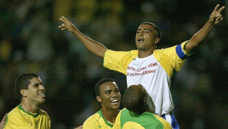 SAO PAULO, BRAZIL:  Brazil soccer star Romario (C) celebrates his goal with his teammates in a friendly match against Guatemala in his retiring homage 27 April, 2005 at Pacaembu stadium, in Sao Paulo, Brazil. AFP PHOTO/Mauricio LIMA  (Photo credit should read MAURICIO LIMA/AFP/Getty Images)