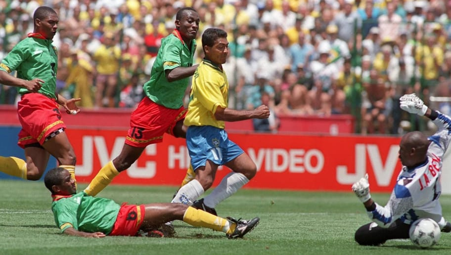 STANFORD, UNITED STATES:  Brazilian forward Romario (C) kicks the ball past Cameroon's goalkeeper Joseph Antoine Bell to score his team's first goal during their World Cup first round soccer match, 24 June 1994 in Stanford, as Cameroon's defenders (from L) Rigobert Song, Thomas Libiih and Raymond Kalla look on. Brazil won 3-0.  AFP PHOTO/PATRICK HERTZOG (Photo credit should read PATRICK HERTZOG/AFP/Getty Images)