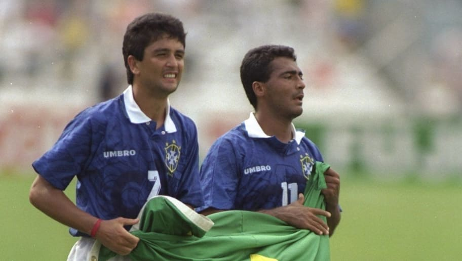 7 Sep 1994:  Bebeto and Romario of Brazil hold the Brazilian flag after their victory in the World Cup match against Holland at the Cotton Bowl in Dallas, Texas, USA. Brazil won the match 3-2. Mandatory Credit: David  Cannon/Allsport