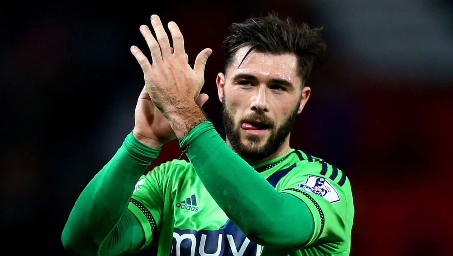 MANCHESTER, ENGLAND - JANUARY 23: Charlie Austin of Southampton applauds the away supporters after his team's 10 win in the Barclays Premier League match between Manchester United and Southampton at Old Trafford on January 23, 2016 in Manchester, England.  (Photo by Michael Steele/Getty Images)