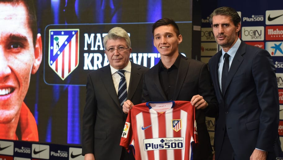 New Atletico de Madrid's Argentinian midfielder Matias Kranevitter (C) poses with his new jersey and Atletico de Madrid's president Enrique Cerezo (L) and Atletico de Madrid sport manager Jose Luis Perez Caminero during his presentation at the Vicente Calderon stadium in Madrid, on January 4, 2016.  / AFP / PEDRO ARMESTRE        (Photo credit should read PEDRO ARMESTRE/AFP/Getty Images)
