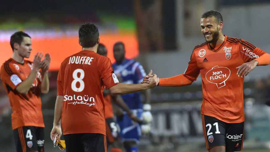 Lorient's Burkinabe midfielder Alain Traore (R) celebrates with Lorient's French midfielder Yann Jouffre (C) and Lorient's French defender Vincent Le Goff (L) at the end of the French L1 football match between Lorient and Reims on January 30, 2016 in Lorient, western France.     AFP PHOTO / LOIC VENANCE / AFP / LOIC VENANCE        (Photo credit should read LOIC VENANCE/AFP/Getty Images)
