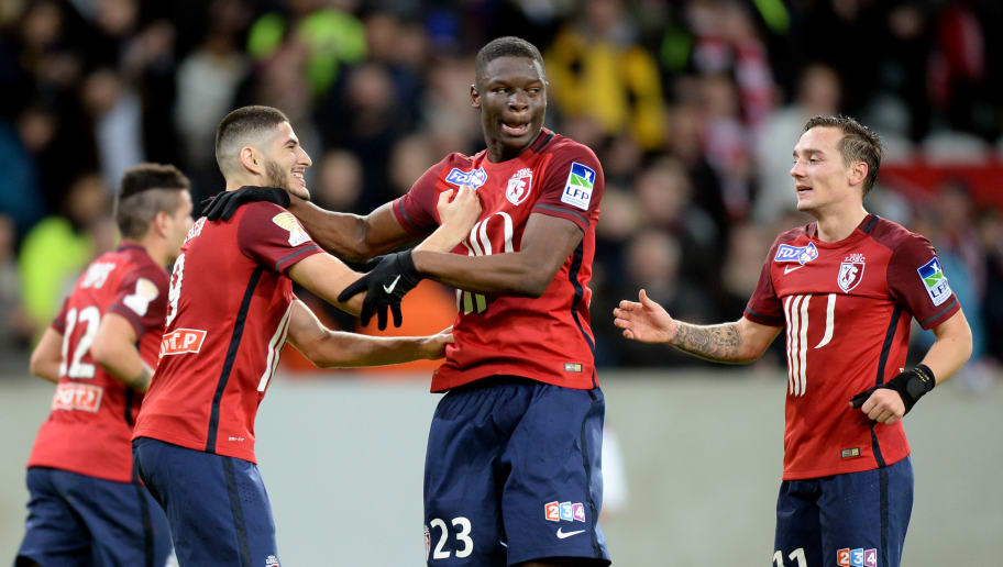 Lille's French defender Adama Soumaoro (C) is congratulated by a teammates  after scoring a goal during the French League Cup football match Lille (LOSC) versus Bordeaux at the Stade Pierre Mauroy stadium in Villeneuve-d'Ascq, northern France, on January 26, 2016. AFP PHOTO / DENIS CHARLET / AFP / DENIS CHARLET        (Photo credit should read DENIS CHARLET/AFP/Getty Images)