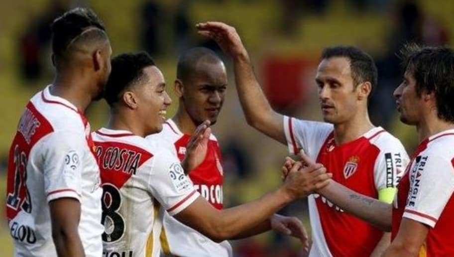 Monaco's Portuguese midfielder Helder Costa (2nd L) celebrates with teammates after scoring a goal during the French L1 football match Monaco (ASM) vs Toulouse (TFC) on January 24, 2016 at the Louis II Stadium in Monaco