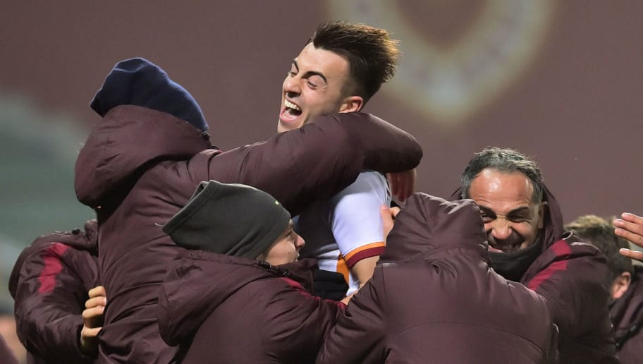 Roma's forward from Italy Stephan El Shaarawy celebrates with teammates after scoring during the Italian Serie A football match between Sassuolo and AS Roma at 'Mapei Stadium'  in Reggio Emilia on February 2, 2016. AFP PHOTO / GIUSEPPE CACACE / AFP / GIUSEPPE CACACE        (Photo credit should read GIUSEPPE CACACE/AFP/Getty Images)