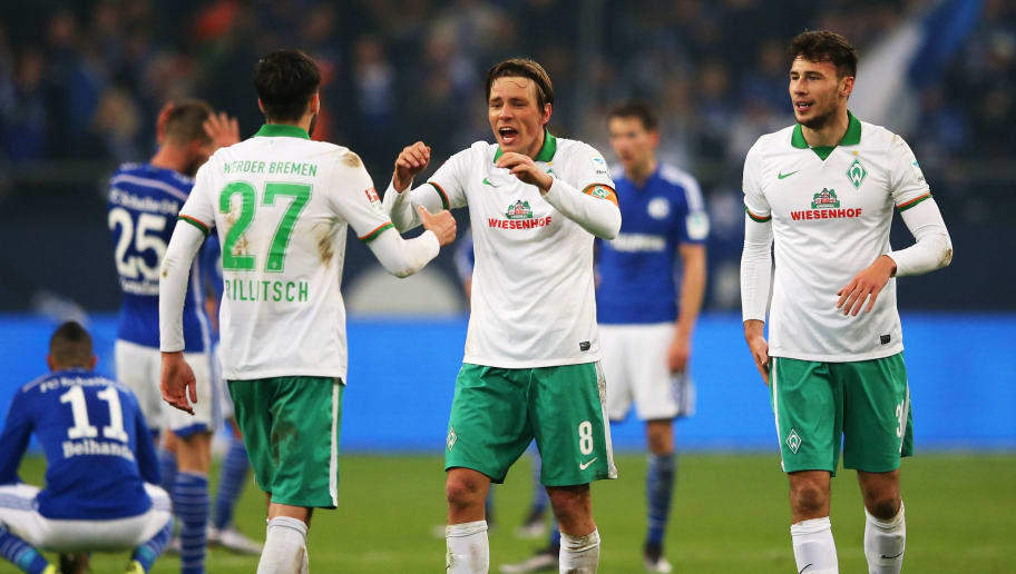 GELSENKIRCHEN, GERMANY - JANUARY 24:  Clemens Fritz (8) and Florian Grillitsch of Werder Bremen (27) celebrate victory after the Bundesliga match between FC Schalke 04 and Werder Bremen at Veltins-Arena on January 24, 2016 in Gelsenkirchen, Germany.  (Photo by Lars Baron/Bongarts/Getty Images)