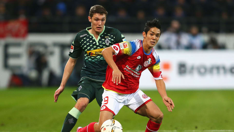 MAINZ, GERMANY - JANUARY 29: Yoshinori Muto of FSV Mainz is closed down by Andreas Christensen of Borussia Moenchengladbach during the Bundesliga match between 1. FSV Mainz 05 and Borussia Moenchengladbach at Coface Arena on January 29, 2016 in Mainz, Germany.  (Photo by Alex Grimm/Bongarts/Getty Images)