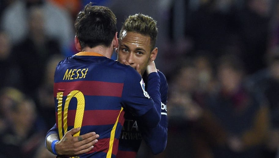 Barcelona's Argentinian forward Lionel Messi (L) talks wih Barcelona's Brazilian forward Neymar after scoring a goal during the Spanish Copa del Rey (King's Cup) football match FC Barcelona vs Valencia CF at the Camp Nou stadium in Barcelona on February 3, 2016.   AFP PHOTO / LLUIS GENE / AFP / LLUIS GENE        (Photo credit should read LLUIS GENE/AFP/Getty Images)