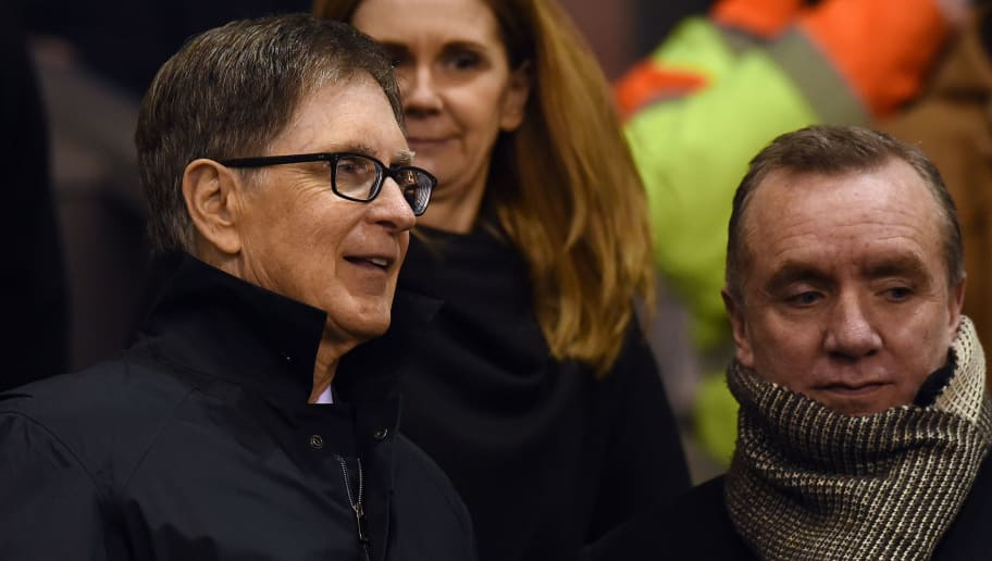 Liverpool's US owner John W. Henry (L) attends the English Premier League football match between Liverpool and Tottenham Hotspur at the Anfield stadium in Liverpool, northwest England, on February 10, 2015.  AFP PHOTO / PAUL ELLIS  RESTRICTED TO EDITORIAL USE. No use with unauthorized audio, video, data, fixture lists, club/league logos or live services. Online in-match use limited to 45 images, no video emulation. No use in betting, games or single club/league/player publications.        (Photo credit should read PAUL ELLIS/AFP/Getty Images)