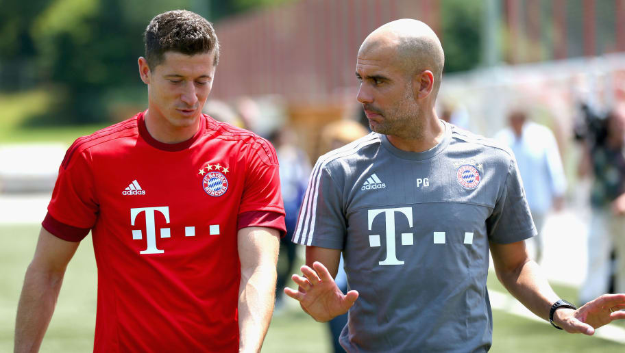MUNICH, GERMANY - JULY 16:  Robert Lewandowski arrives with  head coach Josep Guardiola for the FC Bayern Muenchen team presentation at Bayern's trainings ground Saebener Strasse on July 16, 2015 in Munich, Germany.  (Photo by Alexander Hassenstein/Bongarts/Getty Images)