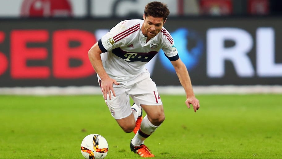 LEVERKUSEN, GERMANY - FEBRUARY 06: Xabi Alonso of Muenchen falls during the Bundesliga match between Bayer Leverkusen and FC Bayern Muenchen at BayArena on February 6, 2016 in Leverkusen, Germany.  (Photo by Alex Grimm/Bongarts/Getty Images)