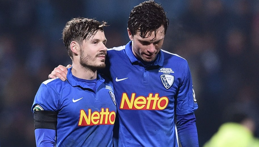 BOCHUM, GERMANY - FEBRUARY 10:  Stefano Celozzi of VfL Bochum (L) and Tim Hoogland of VfL Bochum look dejected following the final whistle during the DFB Cup quarter final match between VfL Bochum and Bayern Muenchen at Rewirpower Stadium on February 10, 2016 in Bochum, Germany.  (Photo by Dennis Grombkowski/Bongarts/Getty Images)
