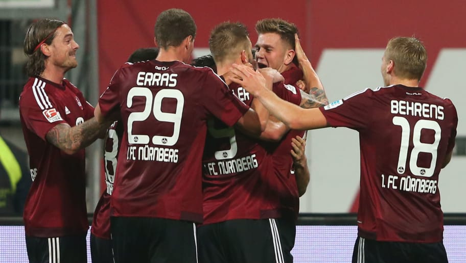 NUREMBERG, GERMANY - DECEMBER 04:  Niclas Fuellkrug (2nd R) of Nuernberg celebrates scoring the opening goal with his team mates during the Second Bundesliga match between 1. FC Nuernberg and SC Paderborn 07 at Grundig-Stadion on December 4, 2015 in Nuremberg, Germany.  (Photo by Alexander Hassenstein/Bongarts/Getty Images)