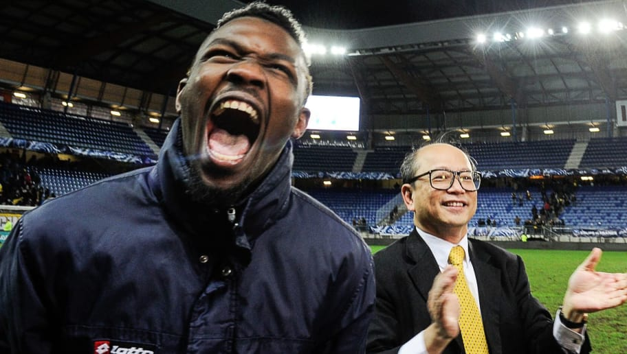 Sochaux' owner, Chinese Li Wing-Sang (R), jubilates with Sochaux' French forward Marcus Thuram (L) at the end of the French cup round of 8 football match between Sochaux (FCSM) and Monaco (ASM) at the Auguste Bonal Stadium in Montbeliard, on February 9, 2016. / AFP / SEBASTIEN BOZON        (Photo credit should read SEBASTIEN BOZON/AFP/Getty Images)