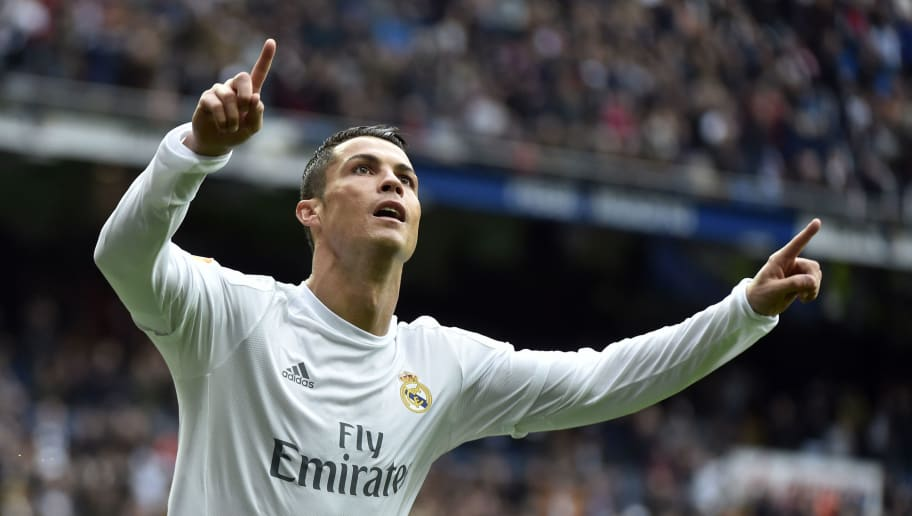 Real Madrid's Portuguese forward Cristiano Ronaldo celebrates after scoring during the Spanish league football match Real Madrid CF vs Athletic Club Bilbao at the Santiago Bernabeu stadium in Madrid on February 13, 2016. / AFP / GERARD JULIEN        (Photo credit should read GERARD JULIEN/AFP/Getty Images)