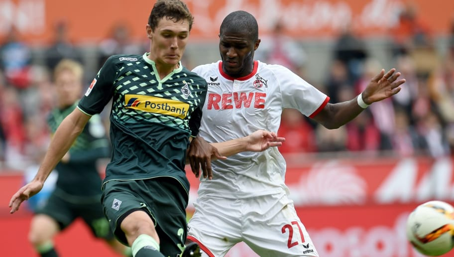 Moenchengladbach's Danish defender Andreas Christensen (L) and Cologne's Cologne's French forward Anthony Modeste vie for the ball during the German first division Bundesliga football match FC Cologne vs Borussia Moenchengladbach in Cologne, western Germany on September 19, 2015.  AFP PHOTO / PATRIK STOLLARZ  RESTRICTIONS: DURING MATCH TIME: DFL RULES TO LIMIT THE ONLINE USAGE TO 15 PICTURES PER MATCH AND FORBID IMAGE SEQUENCES TO SIMULATE VIDEO.  == RESTRICTED TO EDITORIAL USE ==  FOR FURTHER QUERIES PLEASE CONTACT DFL DIRECTLY AT + 49 69 650050.        (Photo credit should read PATRIK STOLLARZ/AFP/Getty Images)