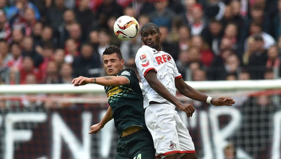 Moenchengladbach's Swiss midfielder Granit Xhaka (L) and Cologne's French forward Anthony Modeste vie for the ball during the German first division Bundesliga football match FC Cologne vs Borussia Moenchengladbach in Cologne, western Germany on September 19, 2015.  AFP PHOTO / PATRIK STOLLARZ  RESTRICTIONS: DURING MATCH TIME: DFL RULES TO LIMIT THE ONLINE USAGE TO 15 PICTURES PER MATCH AND FORBID IMAGE SEQUENCES TO SIMULATE VIDEO.  == RESTRICTED TO EDITORIAL USE ==  FOR FURTHER QUERIES PLEASE CONTACT DFL DIRECTLY AT + 49 69 650050.        (Photo credit should read PATRIK STOLLARZ/AFP/Getty Images)