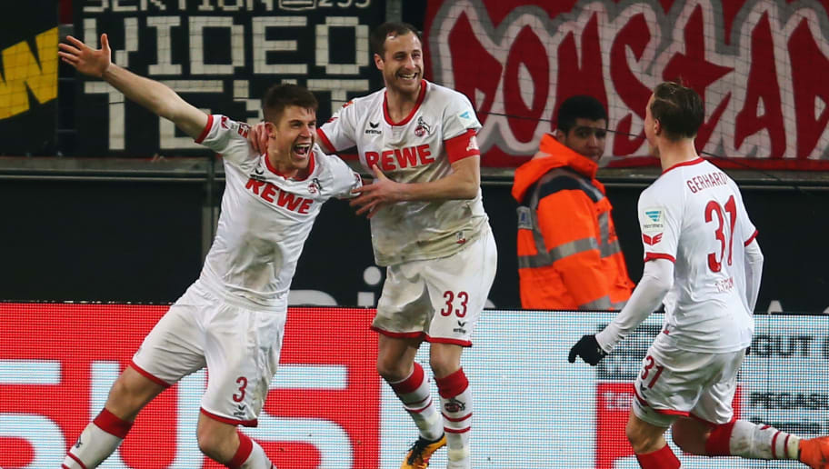 COLOGNE, GERMANY - FEBRUARY 13:  Dominique Heintz (L) of Koeln celebrates his team's second goal with team mates during the Bundesliga match between 1. FC Koeln and Eintracht Frankfurt at RheinEnergieStadion on February 13, 2016 in Cologne, Germany.  (Photo by Alex Grimm/Bongarts/Getty Images)